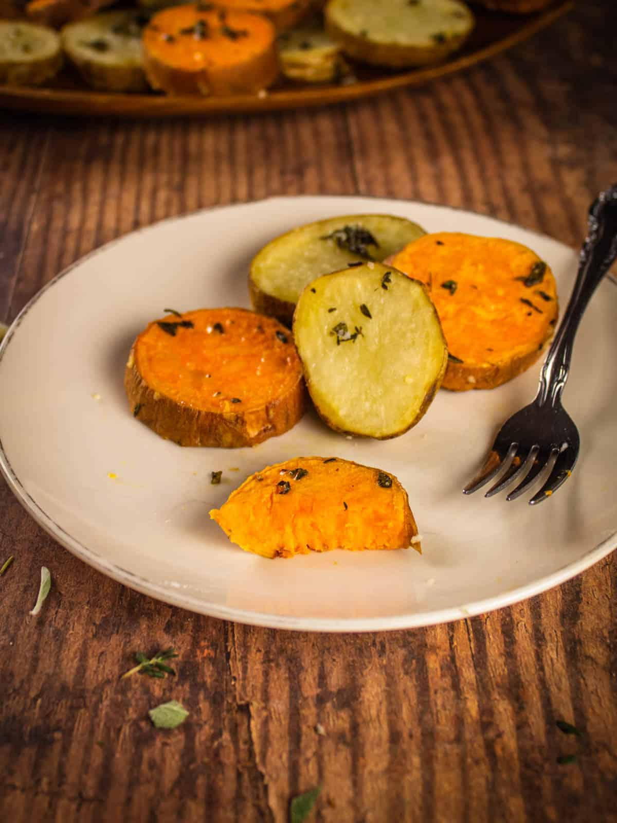 sliced roasted sweet and russet potatoes on a plate