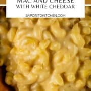 white macaroni and cheese in a wooden bowl