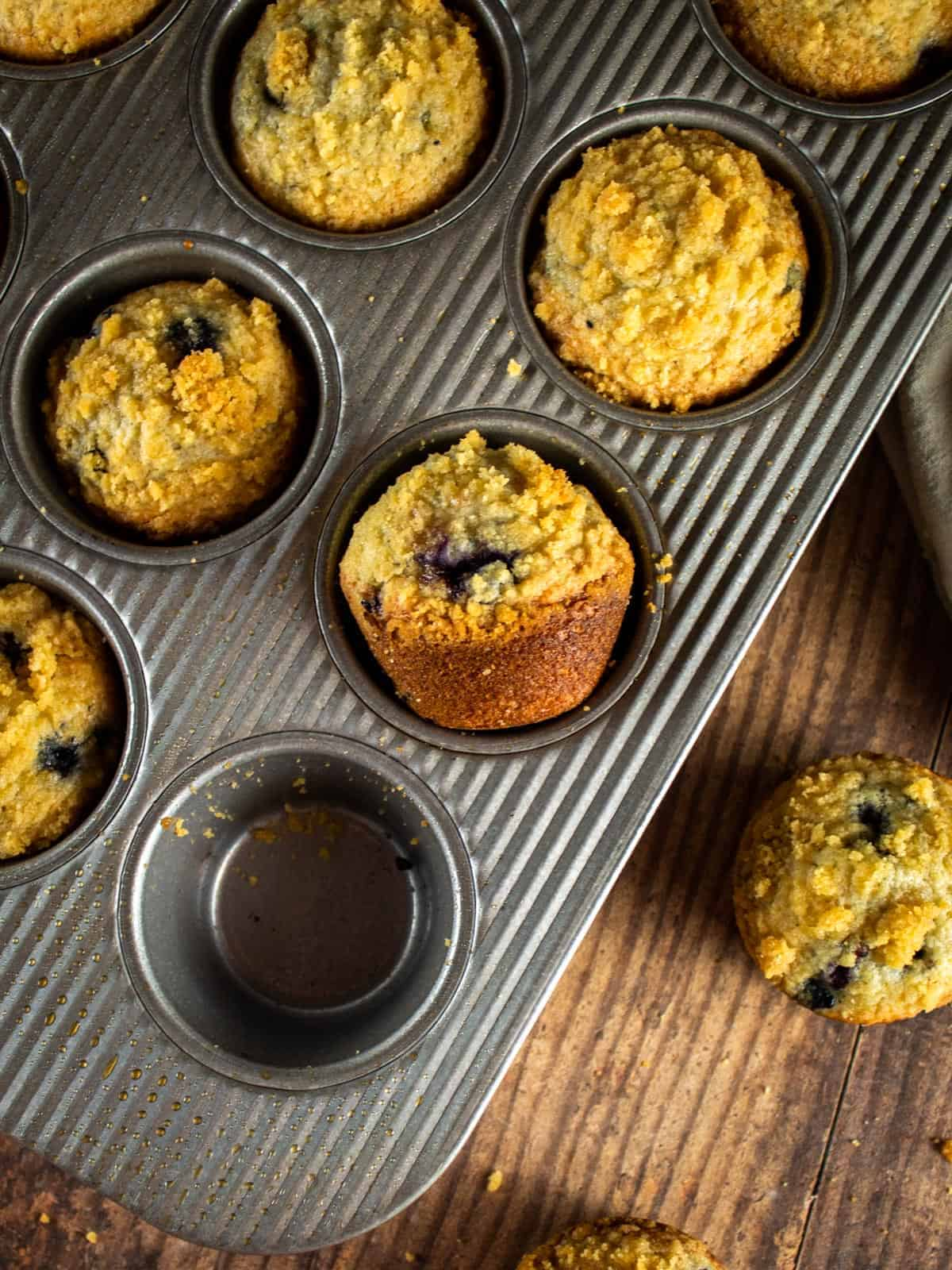 pan of baked blueberry streusel muffins