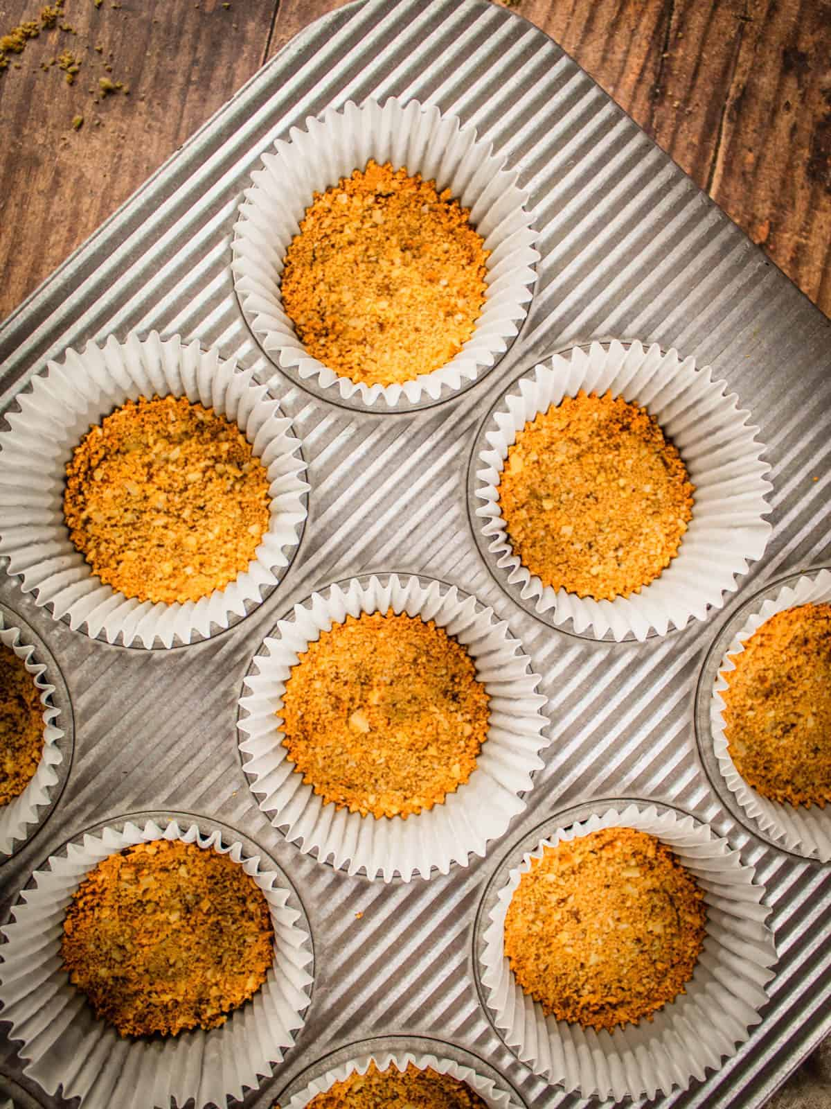 baked graham cracker crumbs in muffin cups