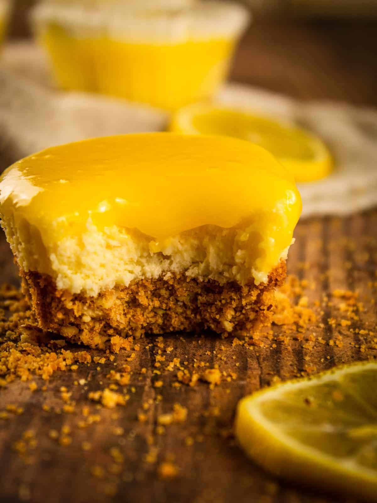 mini cheesecake with lemon curd with a bite in it