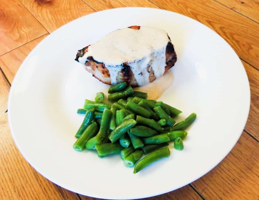 grilled pork chop with white bbq sauce and green beans