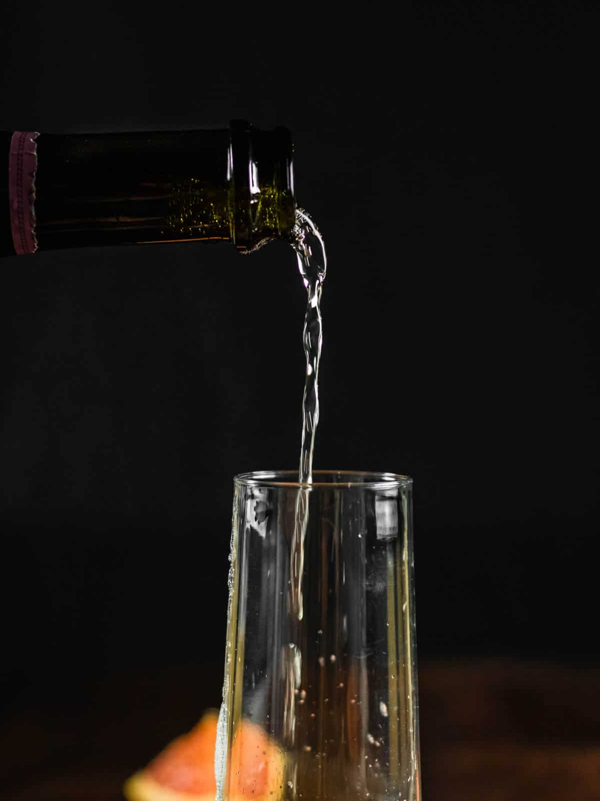 bottle pouring prosecco in a glass