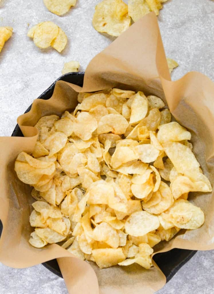 cast iron pan full of plain kettle chips