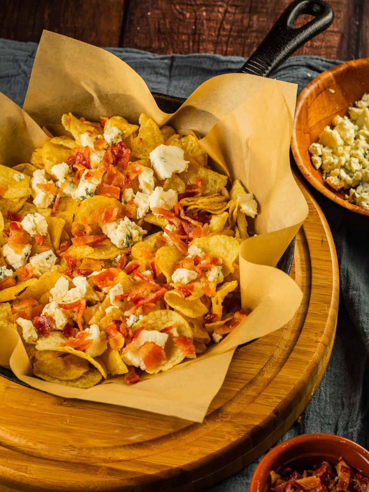 kettle chips sprinkled with bacon pieces and blue cheese crumbles
