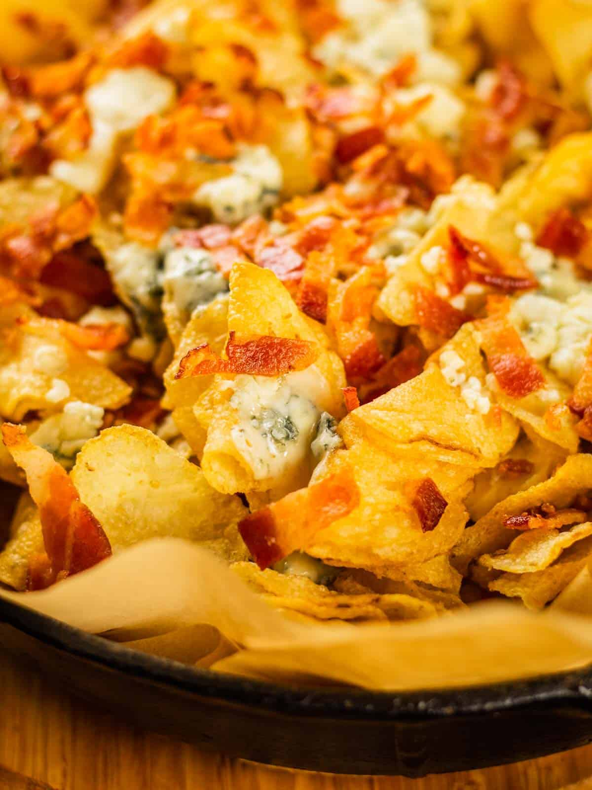 baked kettle chips topped with melted blue cheese and crispy bacon