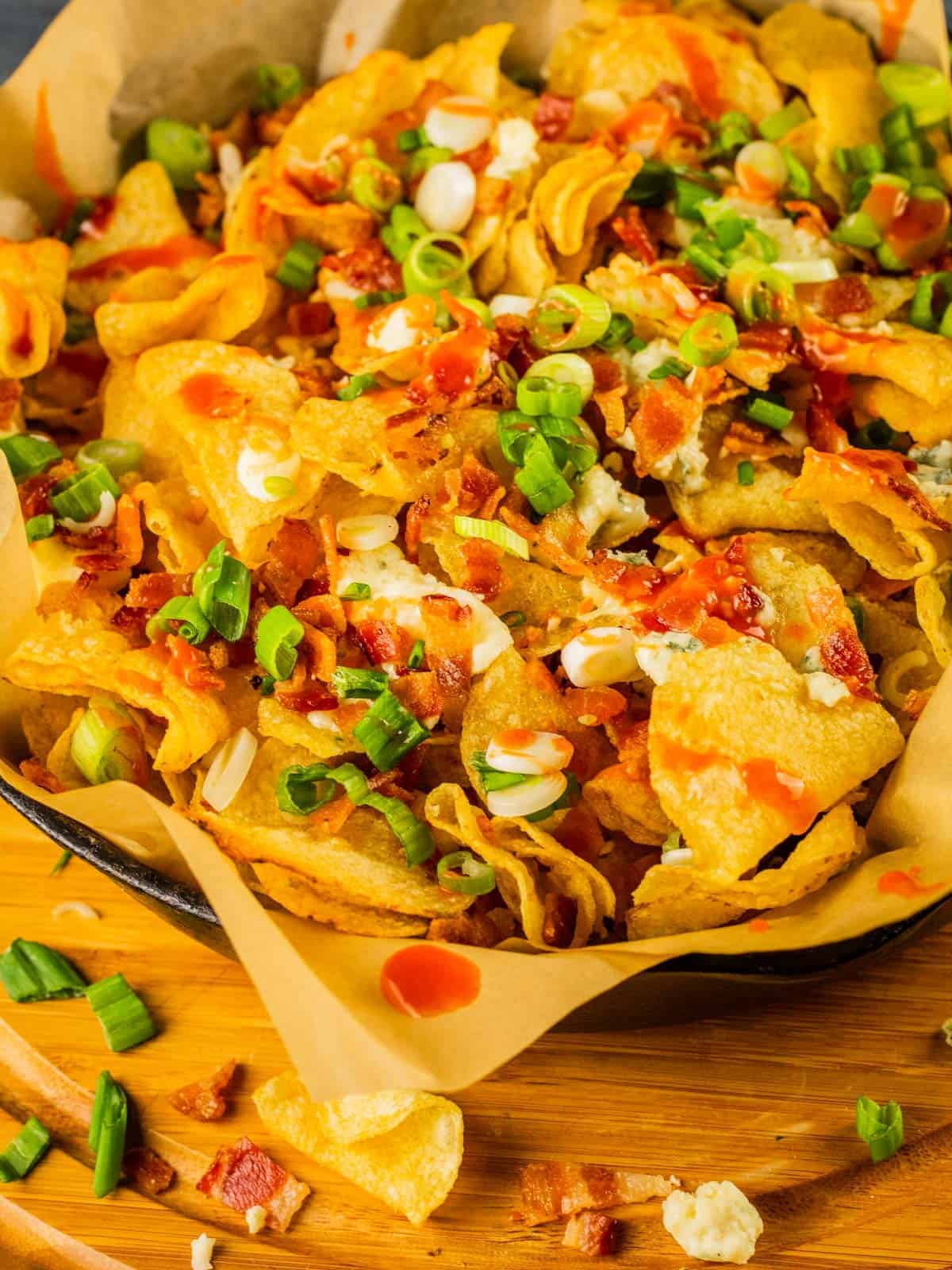chips layered with blue cheese, bacon, scallions and hot sauce