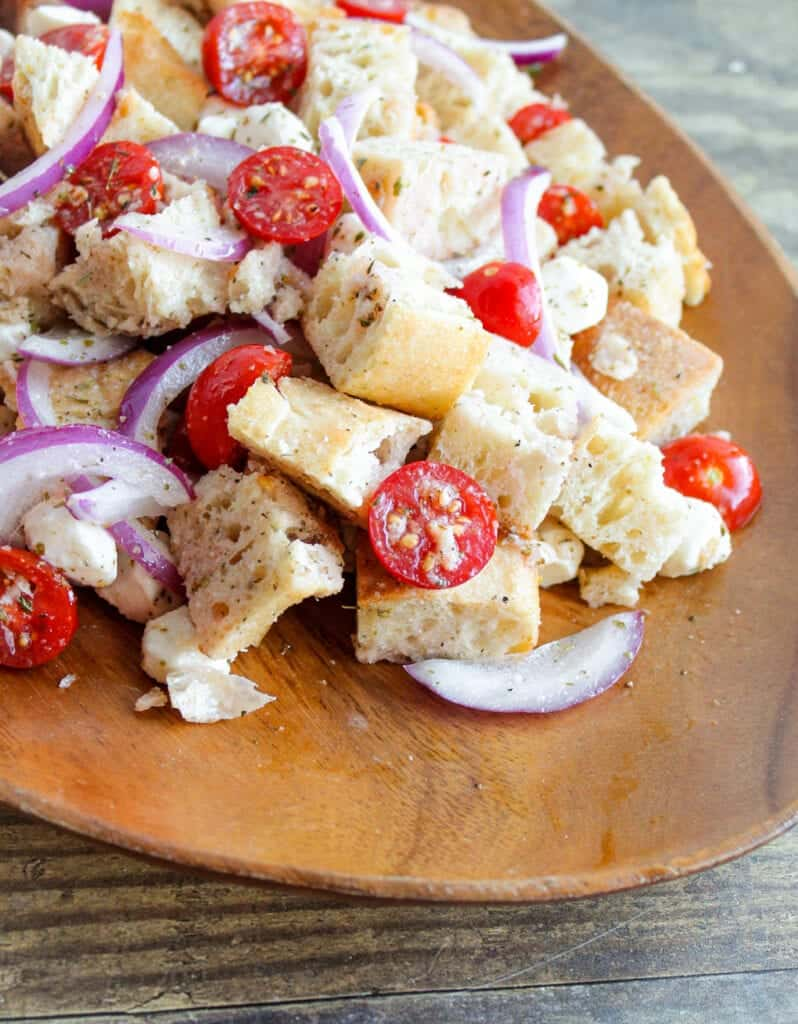 panzanella salad with bread, tomatoes, cheese and red onion