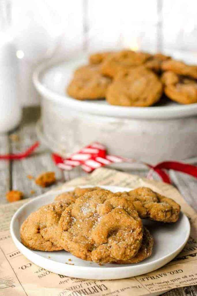 white plate with soft and chewy molasses Christmas cookies laying on a plate