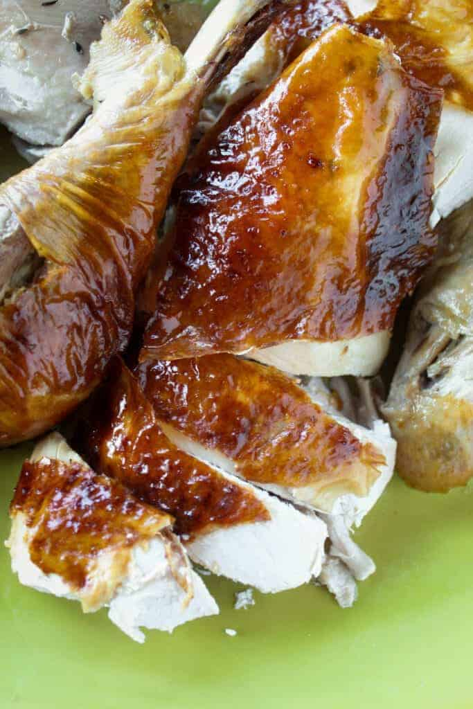 close up shot of a thanksgiving roast turkey breast with crispy skin that has been sliced