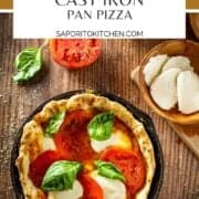 pizza with mozzarella, tomatoes and fresh basil in a cast iron skillet