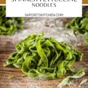 pile of homemade spinach fettuccine noodles tossed in flour