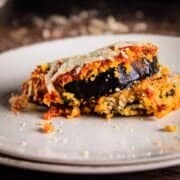 white plate with baked eggplant parmesan