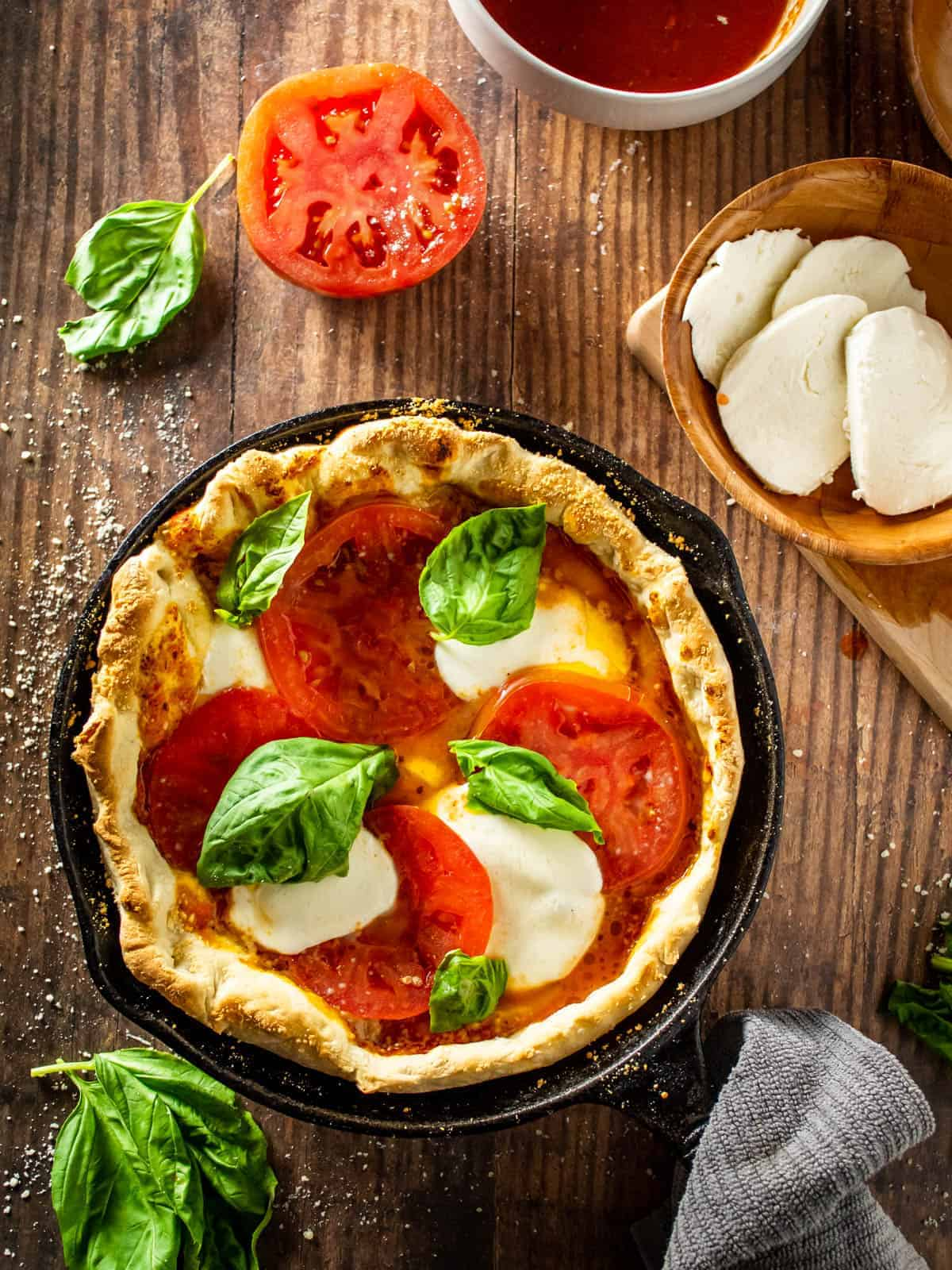 margherita pizza in a cast iron skillet