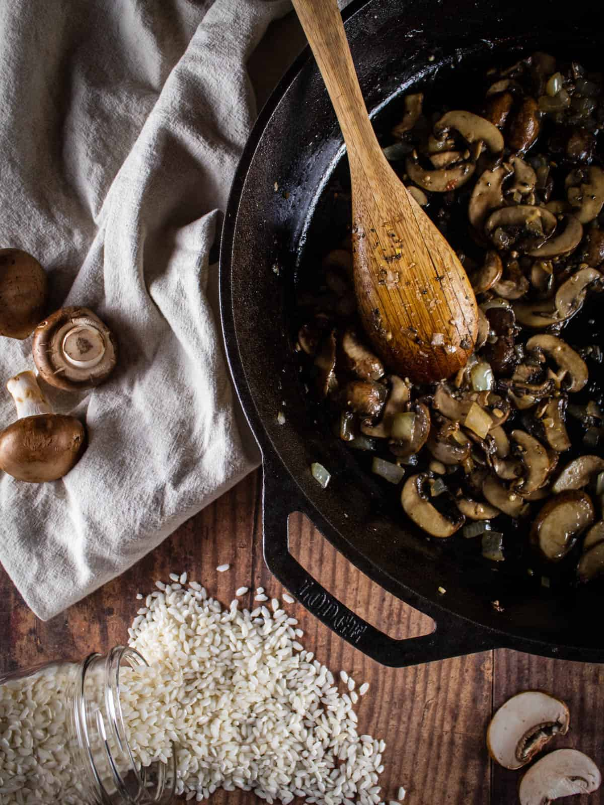 sauteed mushrooms, onions and garlic in a cast iron skillet