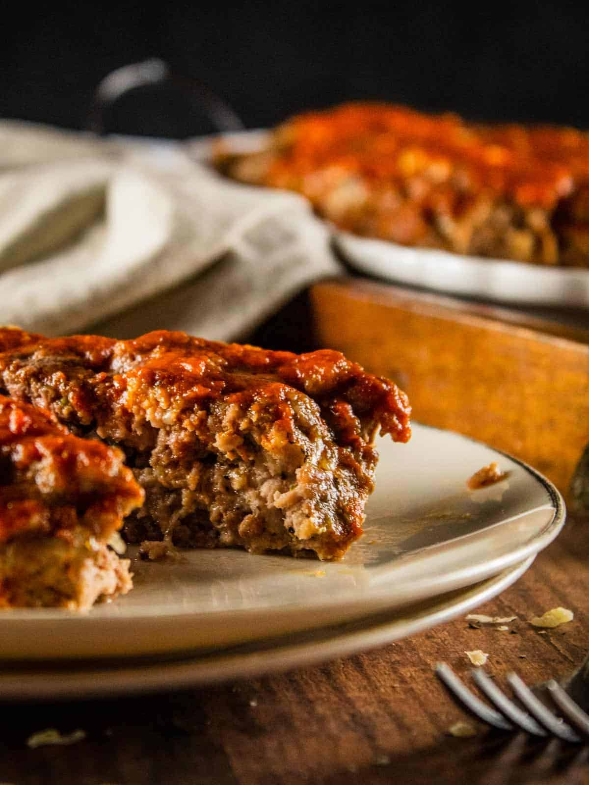 two slices of meatloaf on a plate