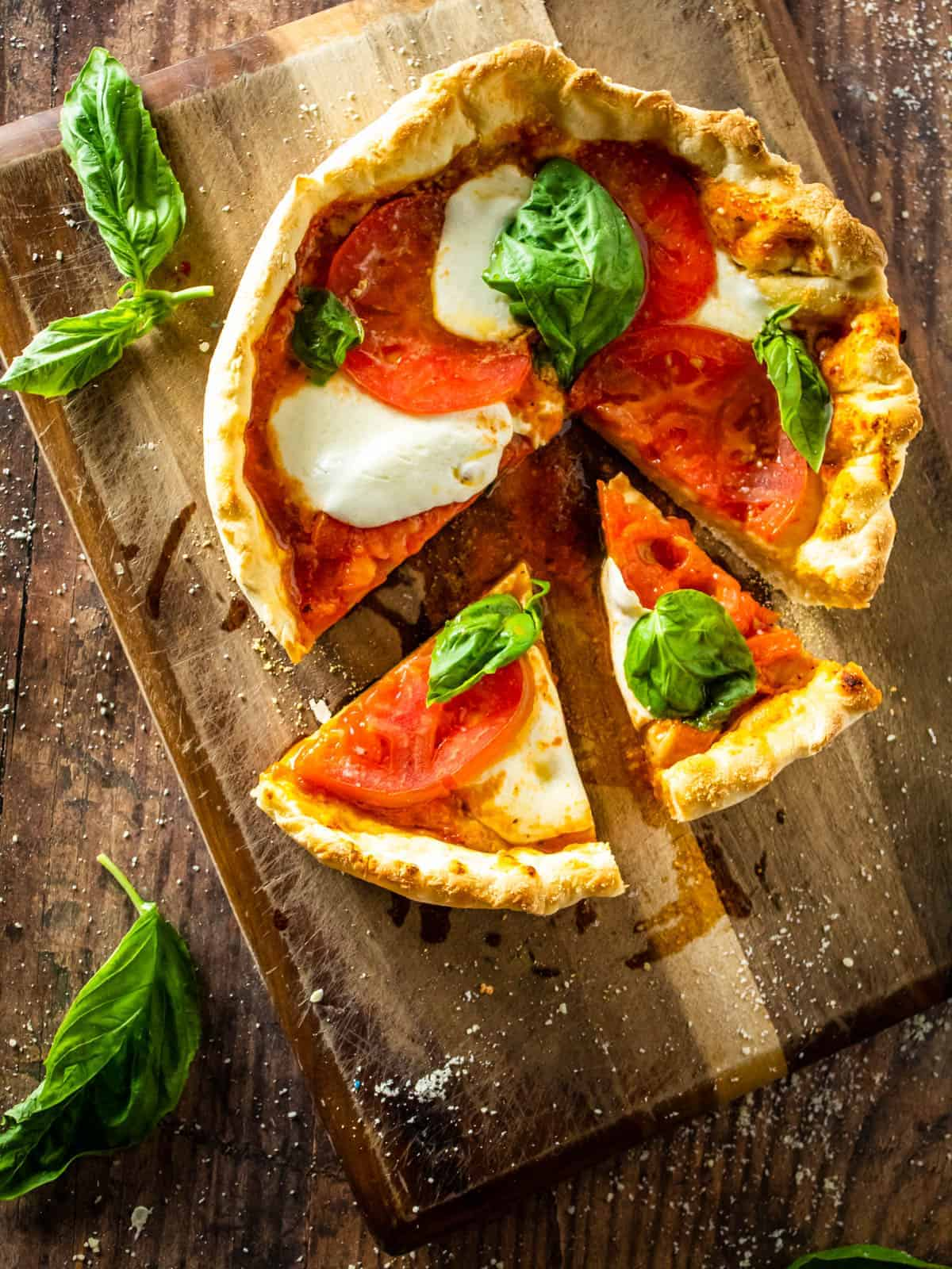 margherita pizza with two slices cut from it