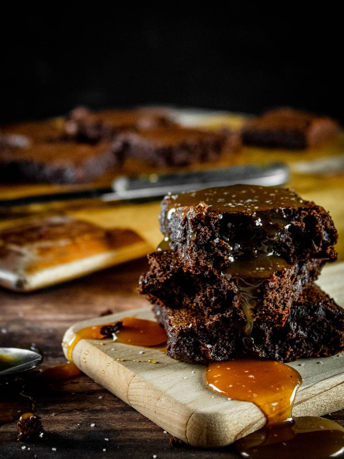stack of brownies with caramel sauce drizzled on them