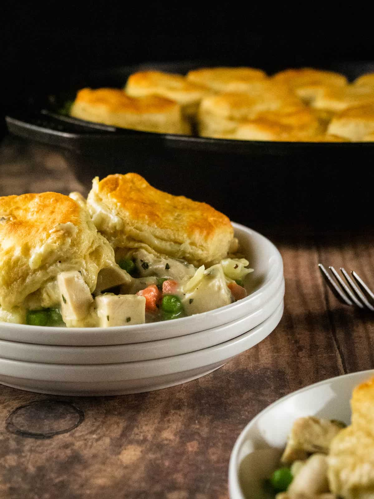 serving of chicken pot pie topped with biscuits