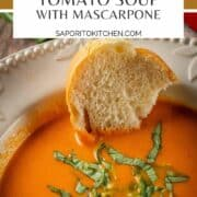 bowl of creamy tomato soup topped with fresh basil