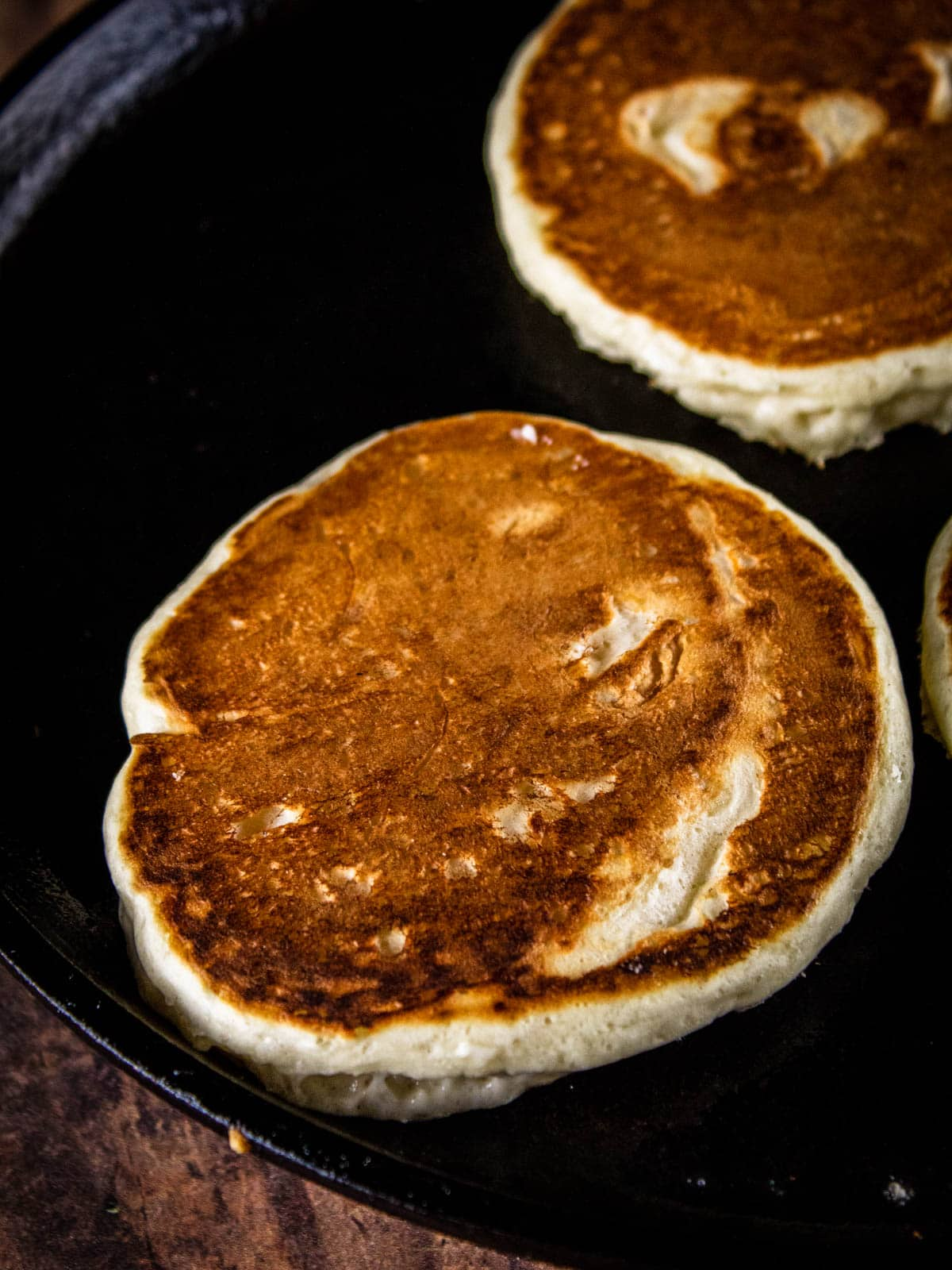 browned pancakes on a griddle pan