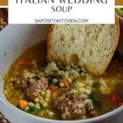 bowl of italian wedding soup with bread in it