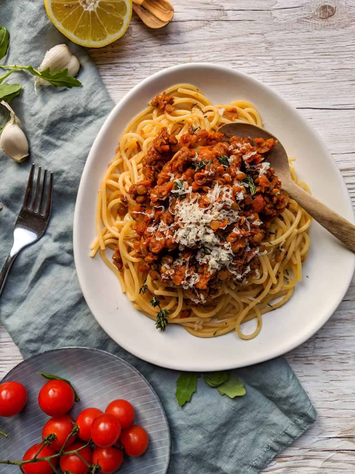 spaghetti covered with lentil bolognese on a plate