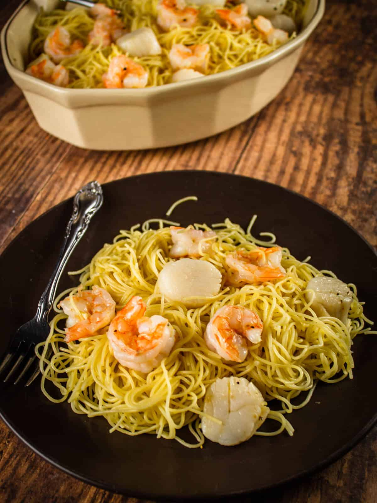 plate with angel hair pasta with scallops and shrimp