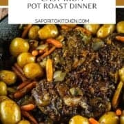 pot roast with potatoes and carrots cooked in a cast iron skillet