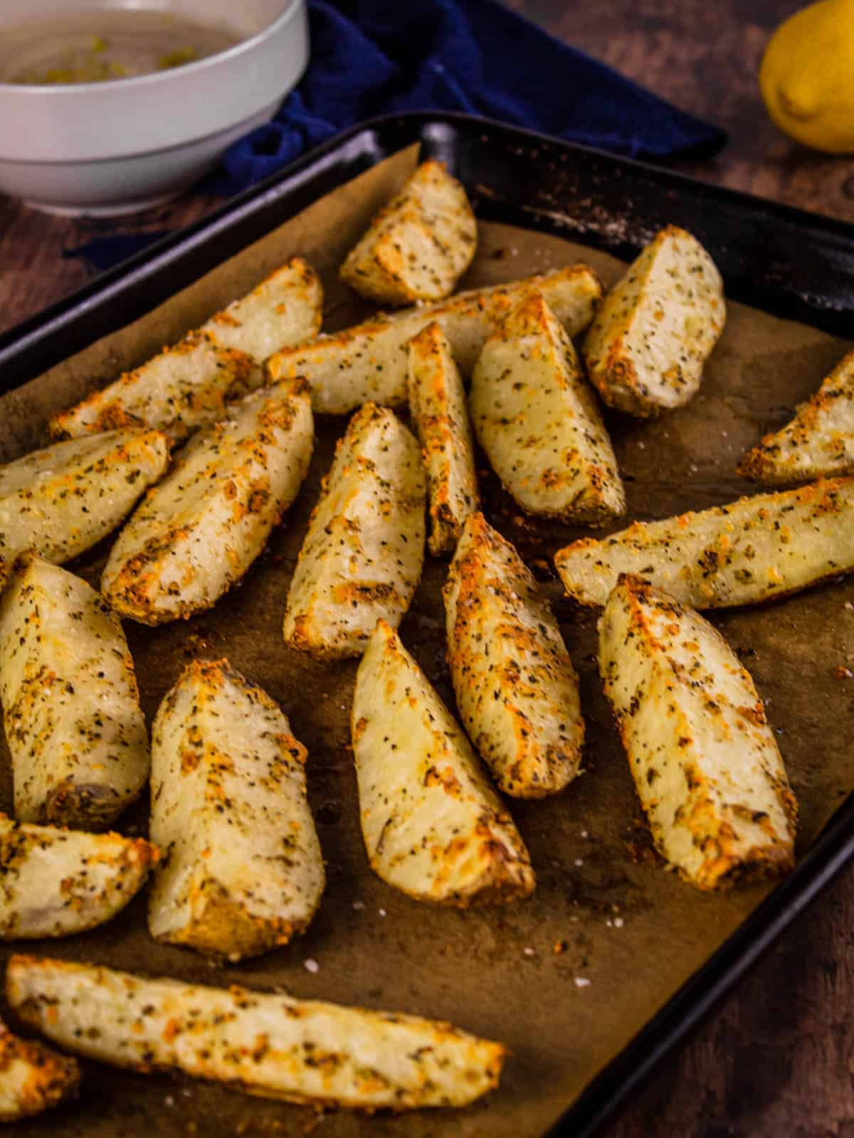 roasted potato wedges on a sheet pan