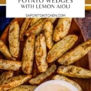 crispy potato wedges on a platter with lemon dip