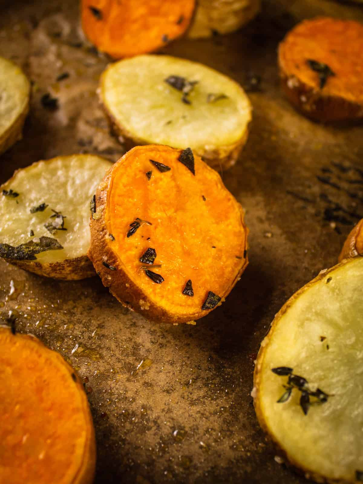roasted white and sweet potatoes with herbs