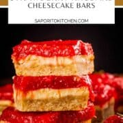 stack of cheesecake bars topped with jam