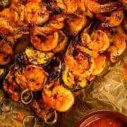 grilled shrimp and vegetable kabobs on a parchment paper