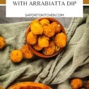 goat cheese balls that are fried in a terracotta container