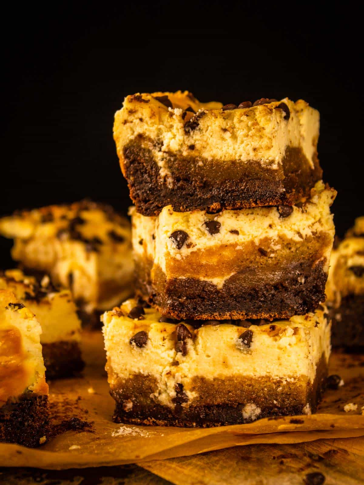 stack of layered brownies with cheesecake and chocolate chips