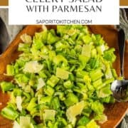 celery and parmesan salad on a wooden platter with a spoon
