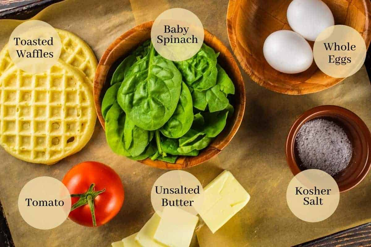 waffles, eggs, spinach, tomato, butter and salt on a sheet pan
