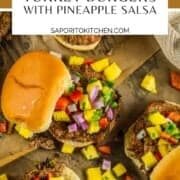 turkey burgers on buns topped with fresh pineapple salsa