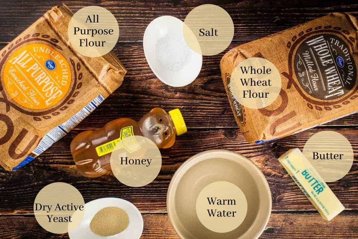 bags of white and wheat flour, salt, yeast, water, stick of butter and honey bottle