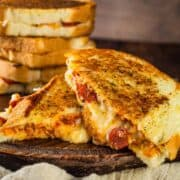 pepperoni pizza grilled cheese cut in half and stacked on each other