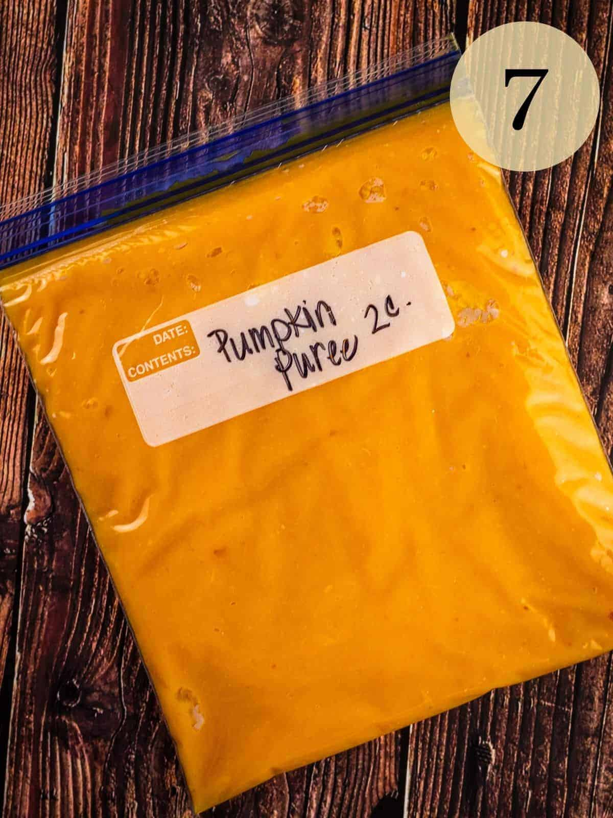 """pumpkin puree in a ziptop bag on a table that is labeled """"pumpkin puree two cups"""""""