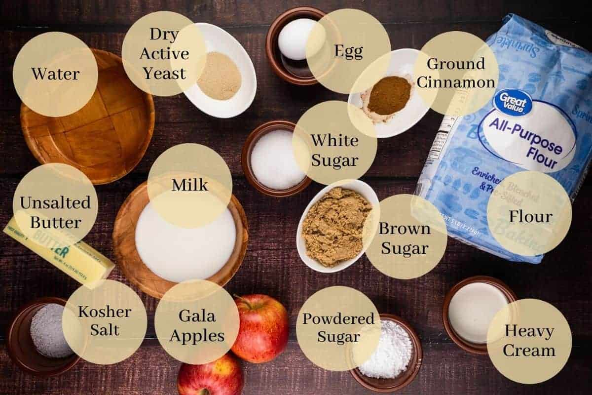 butter, egg, yeast, white, brown and powdered sugars, flour, milk, cinnamon, salt, cream, apples and water